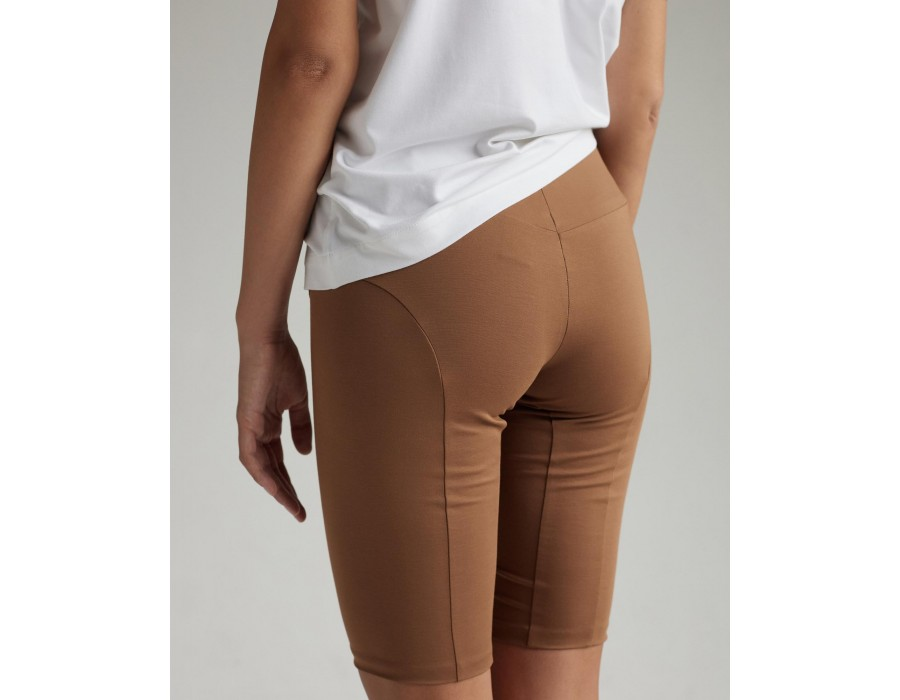 High-waist beige shorts with elastic waistbands and visible seam details