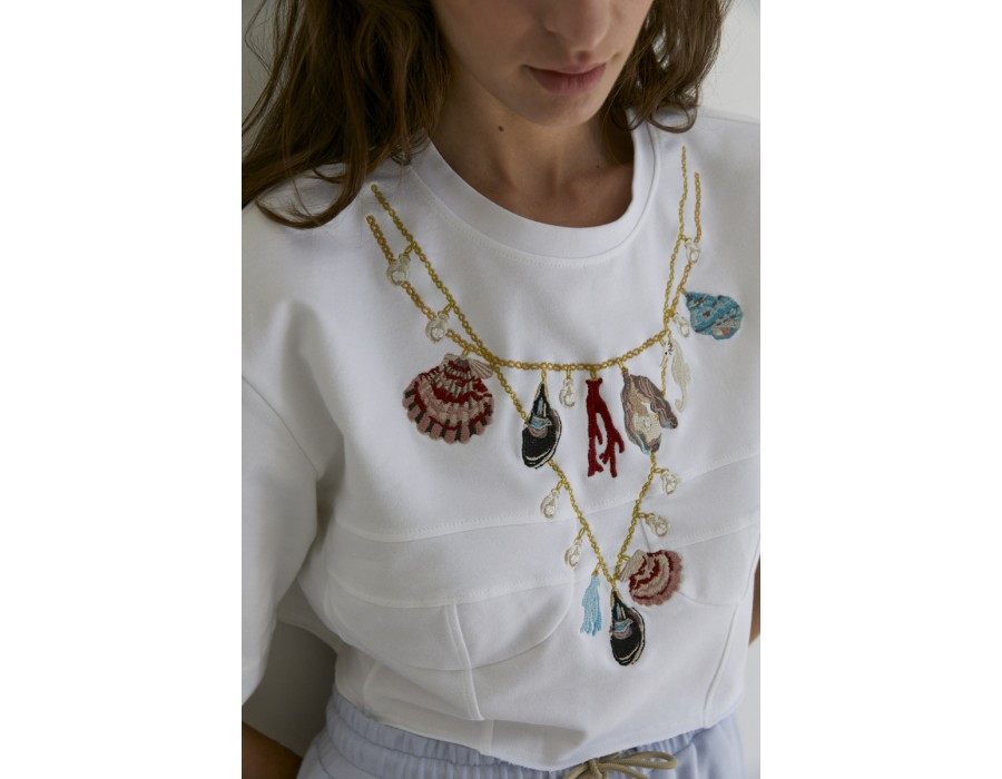 Embroidered top with soft topstitching Sea shells